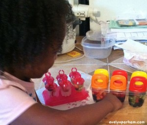 child-helping-make-popsicles