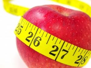 measuring tape around an apple